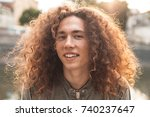 a portrait of a curly guy.... | Shutterstock . vector #740237647