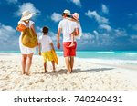back view of a happy family at... | Shutterstock . vector #740240431