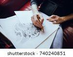 a man draws a picture on a... | Shutterstock . vector #740240851