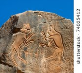 Iconic Engraving of 'The Fighting Cats' (Meercatze) at Wadi Mathendous Archeological Site, Sahara, Libya - UNESCO World Heritage - stock photo