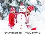children build snowman. kids... | Shutterstock . vector #740259949