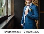 groom in a jacket  boutonniere... | Shutterstock . vector #740260327