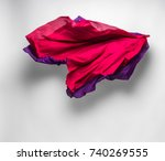piece of red fabric soaring ... | Shutterstock . vector #740269555