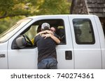 Small photo of GLEN ELLEN, CALIFORNIA/ USA - OCT 14, 2017: Friends reunite at a CHP road block. The man has lost his home. Fires in northern California have burned over 220,000 acres and destroyed 5700 structures.