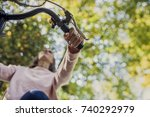 woman riding a bicycle viewed... | Shutterstock . vector #740292979