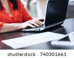 woman typing on laptop at office | Shutterstock . vector #740301661