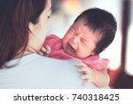 cute asian newborn baby girl... | Shutterstock . vector #740318425