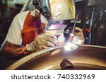 the man in the mask brews... | Shutterstock . vector #740332969