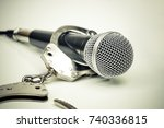 a microphone with handcuffs  ... | Shutterstock . vector #740336815