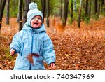 little child walks in the... | Shutterstock . vector #740347969