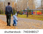 father and son walking in the... | Shutterstock . vector #740348017