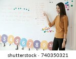 young asian woman teacher... | Shutterstock . vector #740350321