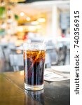 a glass of cola with ice | Shutterstock . vector #740356915