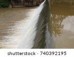 dam water flow | Shutterstock . vector #740392195