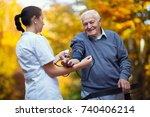 nurse measuring old patient's... | Shutterstock . vector #740406214