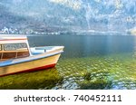 a yellow ferry boat floating on ...   Shutterstock . vector #740452111