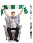 excited sports fan sitting in... | Shutterstock . vector #740454754