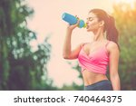 the attractive sportswoman... | Shutterstock . vector #740464375