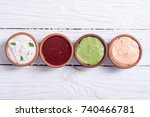 set of sauces in bowl on wooden ... | Shutterstock . vector #740466781