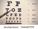 pen pointing to letter in... | Shutterstock . vector #740469799