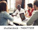 teamwork concept.young creative ... | Shutterstock . vector #740477359