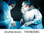 two surgeons in blue robes make ... | Shutterstock . vector #740482081