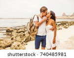 multiracial couple kissing on a ... | Shutterstock . vector #740485981