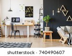 black designer chair at table... | Shutterstock . vector #740490607