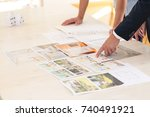 Small photo of Close-up of home seller presenting advantages of property to potential buyer