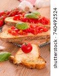 bruschetta bread with basil and ... | Shutterstock . vector #740492524