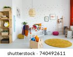 toys in wooden box next to... | Shutterstock . vector #740492611