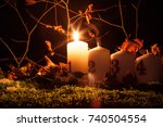advent candles lit on a natural ...   Shutterstock . vector #740504554