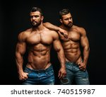 Two Hunks Standing At Black...