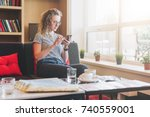 young businesswoman sits on... | Shutterstock . vector #740559001