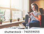 young businesswoman sits on... | Shutterstock . vector #740559055