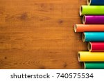 colored vinyl rolls over wooden ... | Shutterstock . vector #740575534