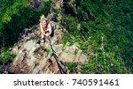 female climber holding in hand... | Shutterstock . vector #740591461