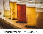 Small photo of Flight of ales, amber colours