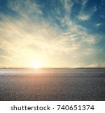 road and sunset sky above city  ... | Shutterstock . vector #740651374