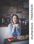beautiful young woman sitting... | Shutterstock . vector #740655634
