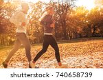 couple of runners jogging a the ... | Shutterstock . vector #740658739