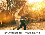 couple of runners jogging a the ... | Shutterstock . vector #740658745