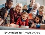 large family presenting cake... | Shutterstock . vector #740669791