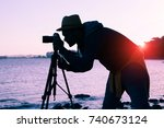 Silhouette Of Photographer At...