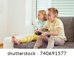 two happy children playing... | Shutterstock . vector #740691577