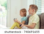 two happy children playing... | Shutterstock . vector #740691655