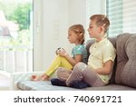 two happy children playing... | Shutterstock . vector #740691721