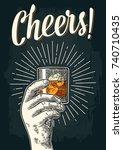 male hand holding glass whiskey ... | Shutterstock .eps vector #740710435