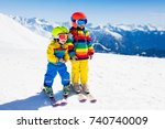 child skiing in the mountains.... | Shutterstock . vector #740740009