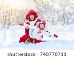mother and baby on sleigh ride. ... | Shutterstock . vector #740770711